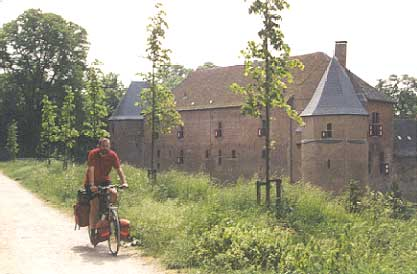 Biker in the Achterhoek with typical castle as a backdrop